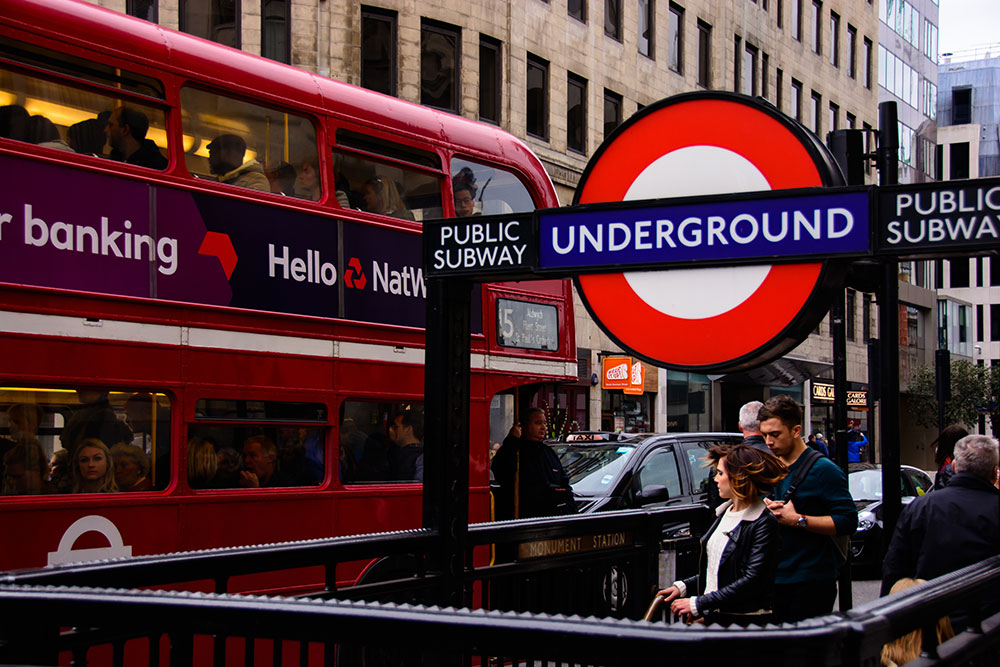 commuters London UK Travel Work Longer Hard