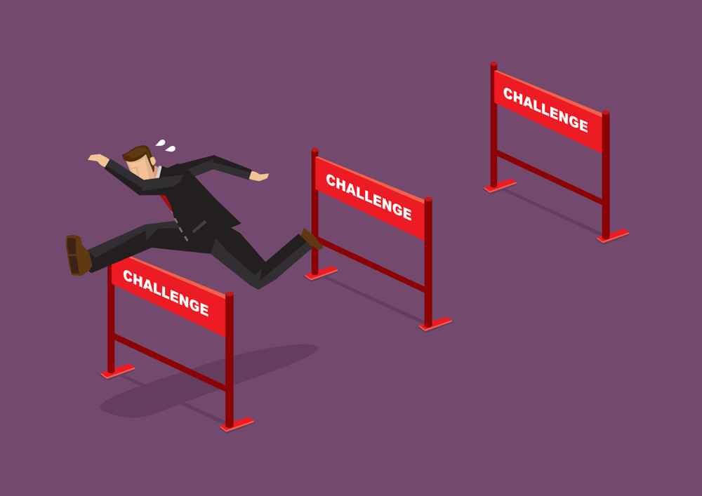 business man jumping over challenge fences